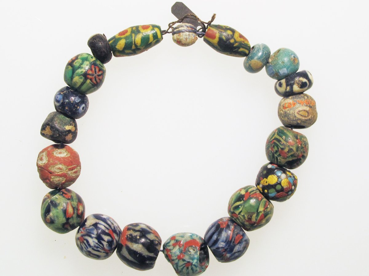 Roman beads in the style that would be typical of Murano, Italy. Multicolored, mosaic-like beads, made of glass. Enough to make a bracelet.