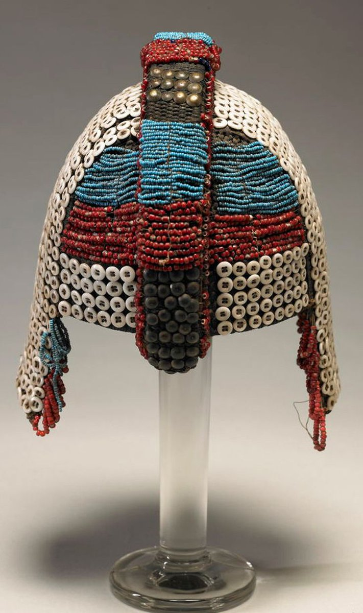 Africa | Man's helmet from the Fang people of Gabon | Bast Fiber, Reed, Animal Hair; Twining, Applied Glass Beads, Buttons And Brass Tacks | 19th to early 20th century - an ornate helmet with bands of beads made of buttons and glass. Via the Fine Arts Museums of San Francisco.