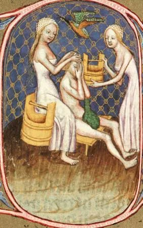 Two women bathing a man in white, long dresses. He is naked save for a very ... intriguingly placed gourd? Wikimedia Commons.