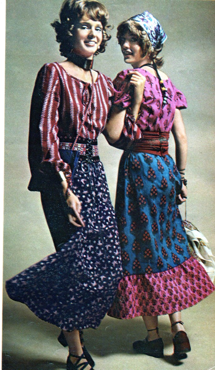 laughing teenage girls in paisley and Indian motif clothing.