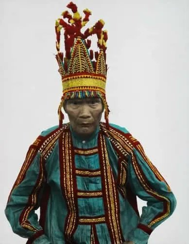 """""""Datus who have killed large numbers of enemies wear a most remarkable head ornament fashioned from cloth of gold, with elaborate scarlet, blue, or white tassels..no other Philippine tribe has anything in the least like it."""" DEAN C. WORCESTER/National Geographic Creative"""