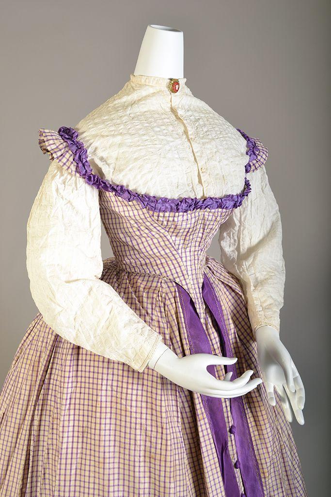 Purple windowpane check dress with cotton seersucker blouse, American, ca. 1860, KSUM 1995.17.53 ab (dress) and KSUM 2008.13.3 (blouse). Kent State University.