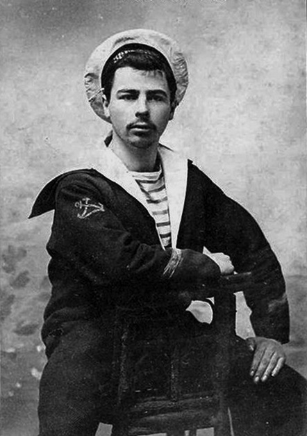 A sailor wearing a Marinière shirts or Breton shirt. From the early 20th century. Public domain.