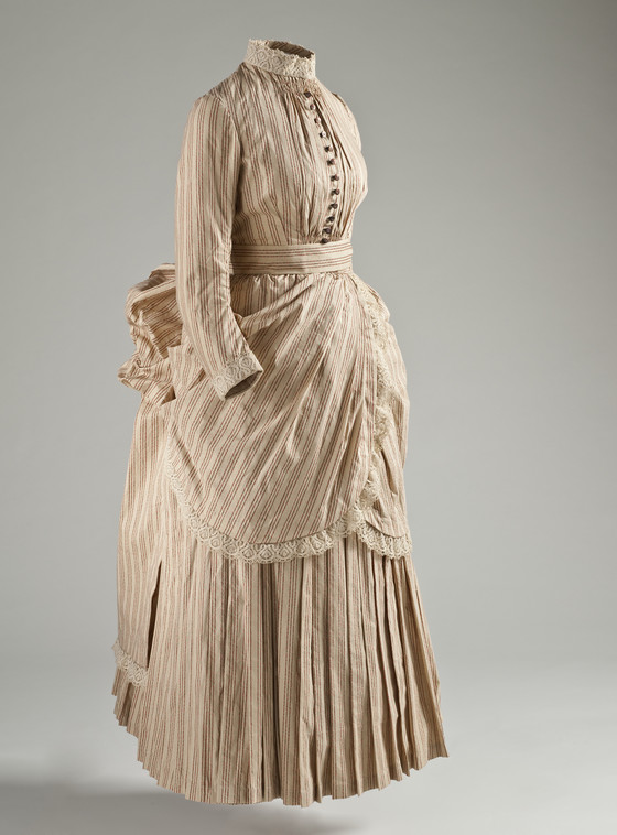 Striped Victorian women's ensemble for playing tennis--pleats at the bottom for movement, cotton for breathability. But still tons of layers and details and in no way comfortable. via LACMA