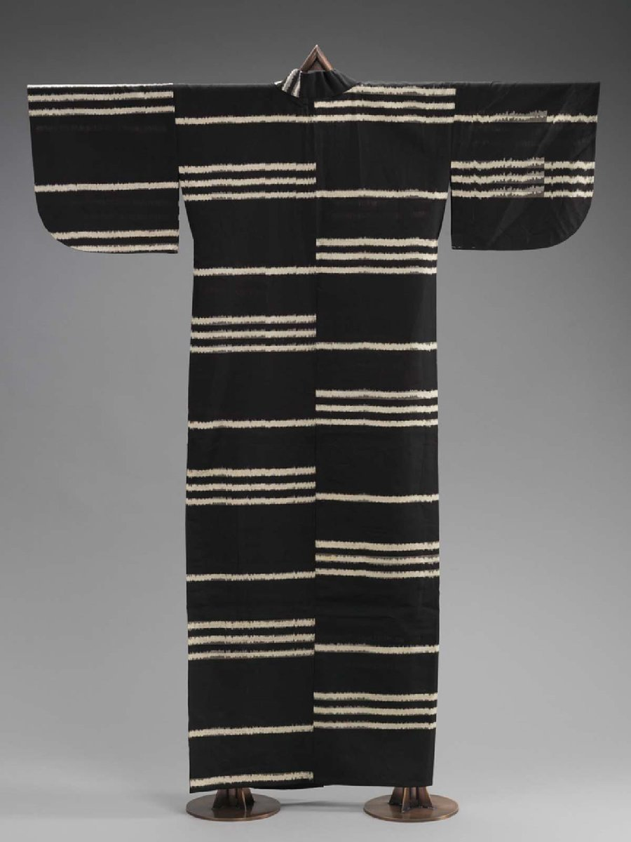Wool kimono, ikat dyed with black ground and white horizontal stripes. The stripes aren't all the way around, they are stacked, and the result is high contrast but high art, too. MFA Boston.