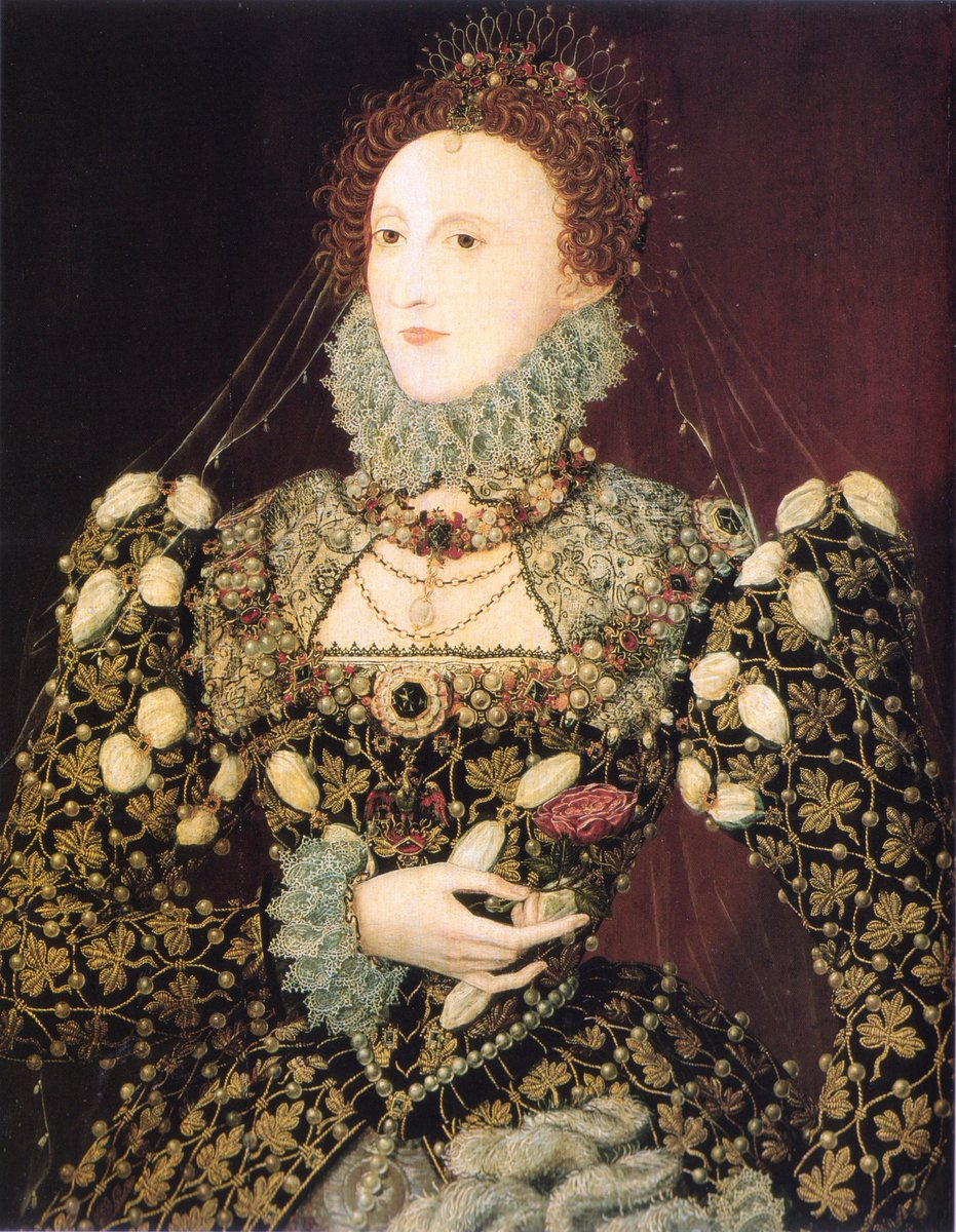"""The """"phoenix"""" portrait of Elizabeth, ascribed to Hilliard, one of her favored paintings. The elaborate jewels and embroidery on her gown make it almost impossible to see her dress design."""