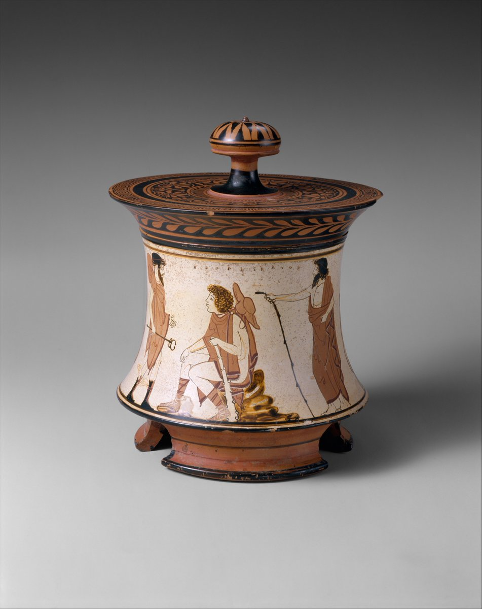 From the Met Museum: During the middle of the fifth century B.C., the white-ground technique was commonly used for lekythoi, oil flasks placed on graves, and for fine vases of other shapes. As classical painters sought to achieve ever more complex effects with the limited possibilities of red-figure, the white background gave new prominence to the glaze lines and polychromy. The decoration of this pyxis reflects the delight with which an accomplished artist like the Penthesilea Painter depicted a traditional subject.