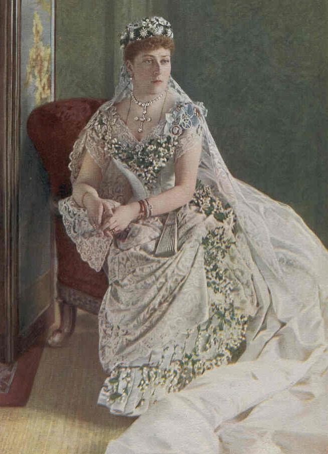 From Wikipedia: On the event of her wedding to Prince Henry of Battenberg at Saint Mildred's Church at Whippingham, near Osborne, on 23 July 1885, Princess Beatrice of the United Kingdom wore a wedding dress of white satin, trimmed with orange blossom and lace,[1] the lace overskirt held by bouquets of the blossom entwined with white heather. There was lace on the pointed neck line, and on the sleeves, for the Princess was a lover of, and an expert on, lace. One of her most treasured possessions was a tunic of old point d'Alençon which had belonged to Catherine of Aragon. Knowing her daughter's love of lace, the Queen allowed Princess Beatrice to wear the Honiton lace and veil which she herself had worn on her wedding day. It was a very precious possession to the Queen, and Princess Beatrice was the only one of her daughters to be given the opportunity to wear it.[1] Her veil was emblazoned with a diamond circlet with diamond stars, a wedding gift from her mothe