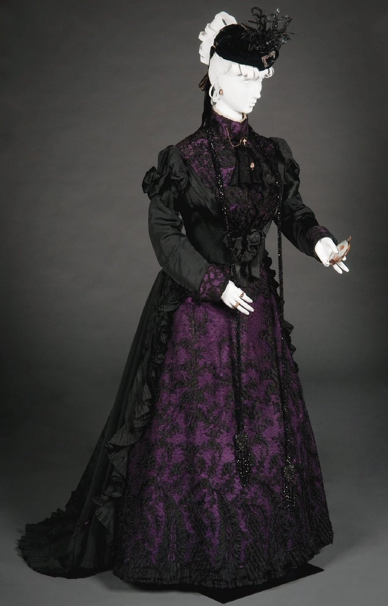 Woman's evening three-piece reception gown in black silk faille with black corded lace over purple faille underlay, consisting of (A) bodice, (B) dickey, and (C) skirt; - FIDM Galleries