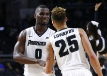 Dec 12, 2015; Providence, RI, USA; Providence Friars forward Ben Bentil (0) and guard Drew Edwards (25) celebrate against the Bryant University Bulldogs during the second half at Dunkin Donuts Center. Mandatory Credit: Mark L. Baer-USA TODAY Sports
