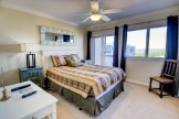 Master Suite with Private Balcony at Pinnacle Port Condo