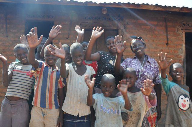 Elizabeth and Family waving