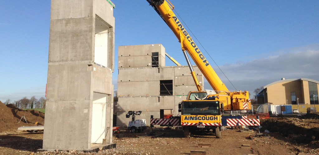 Precast boxes by PCE provide structural solidity for steel framed building