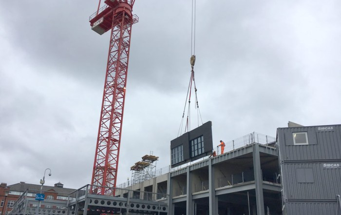 PCEs hybrid construction approach sandwich panel craned in in Manchester