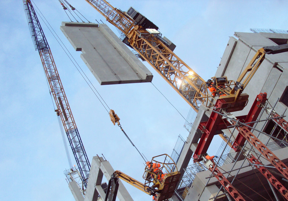 The precast concrete elements are craned into place direct from the unloading area