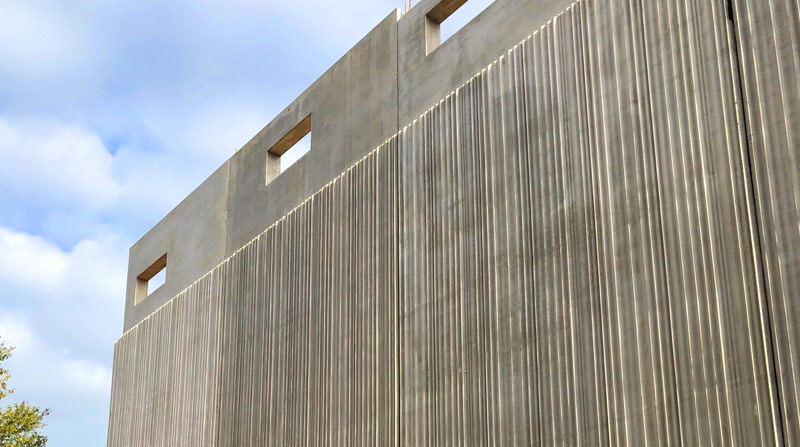 Nine-metre-high architecturally finished pre-cast concrete Auditorium and Core wall panels by PCE