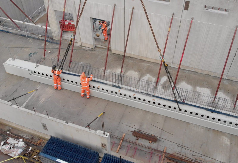 Temporary edge protection was pre-installed to the steel Deltabeams at ground level