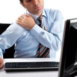 Man holding his sore shoulder