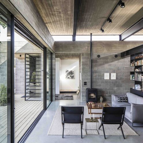 Contemporary-family-room-in-modern-Israeli-home-with-concrete-ceiling