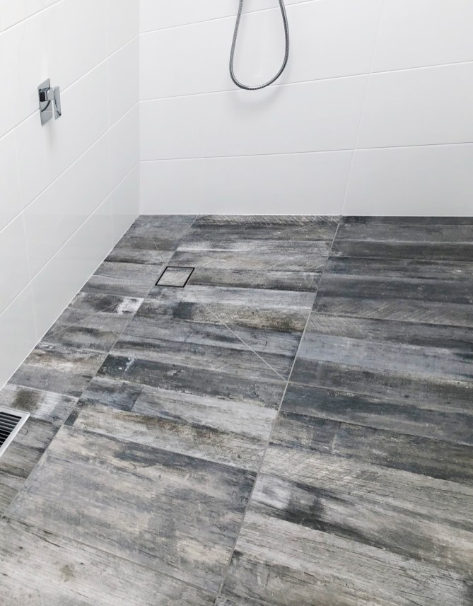 Laundry and bathroom renovation complete with modern grey wood-look tiles