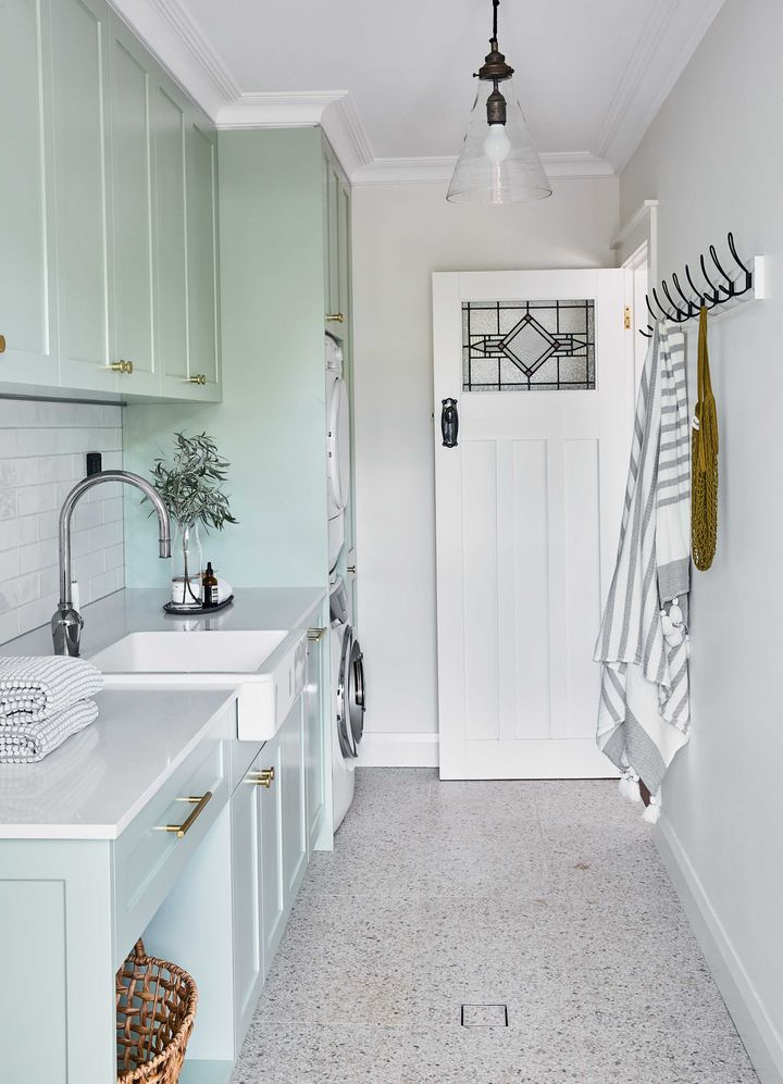 """""""Install stackable front-loading washers and dryers to maximise benchtop space,"""" Sally Rhys-Jones suggests. This Balnei & Colina designed space is the perfect example."""