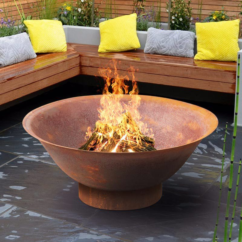 Rusty metal open bowl fire pit