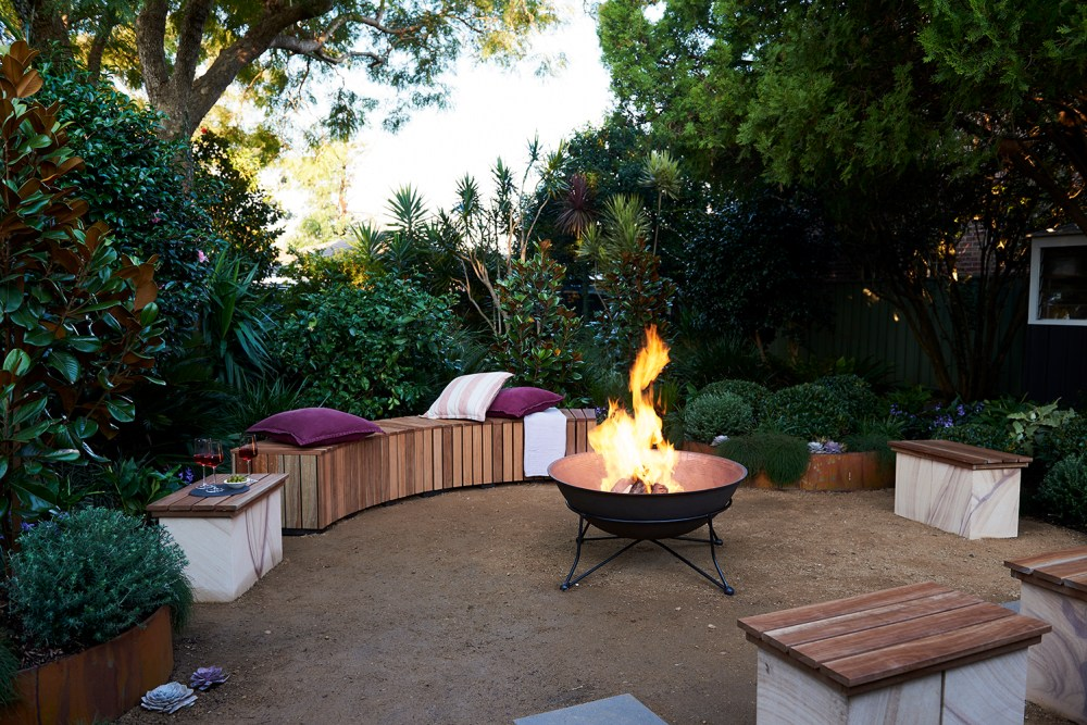 Metal open bowl fire pit with bench seating