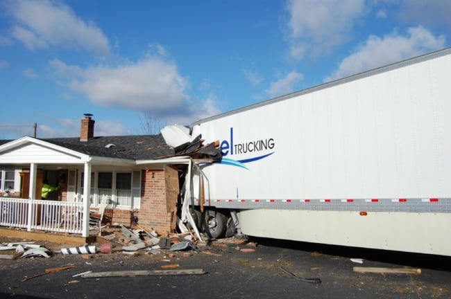Tractor-trailer crashes into house in Carroll County, driver killed