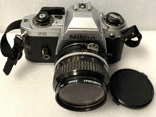 Vintage Nikon FG 35 mm SLR Film Camera with Nikon 50 mm Lens & Rokinon 2000 Camera Flash