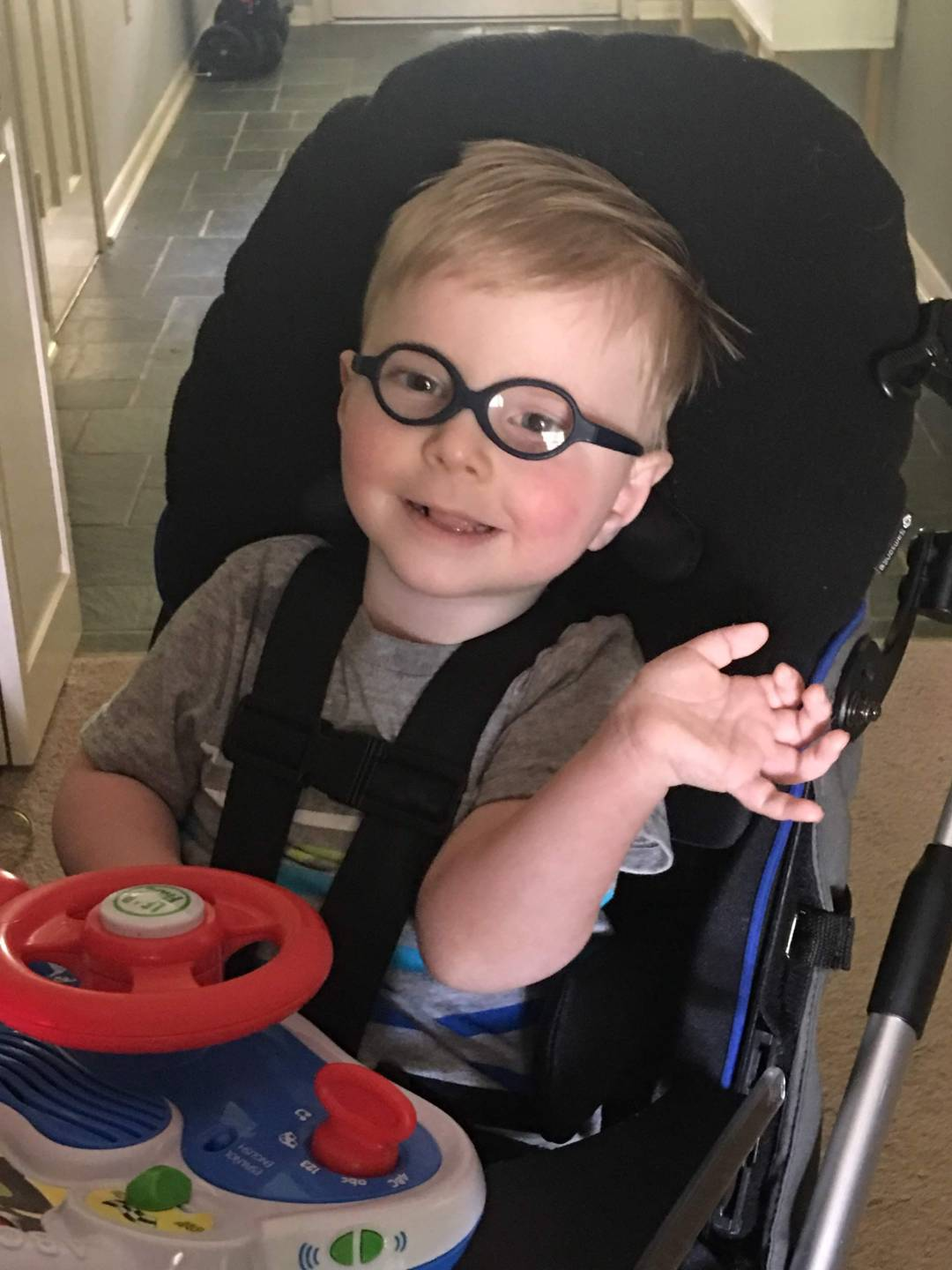 Photo of a toddler with glasses