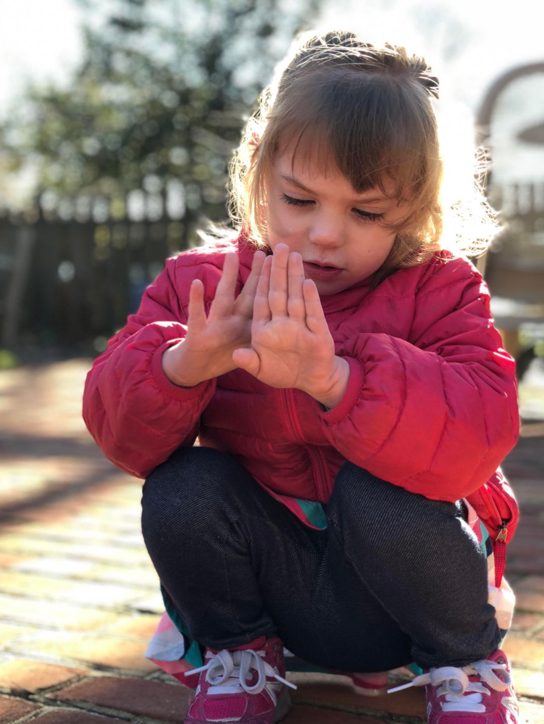 Photo of young girl looking at her hands
