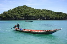 These longboats transfer people from the boats to the sandy beaches
