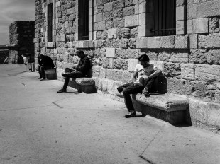 People reading and spending time in the courtyard of Fort St Jean