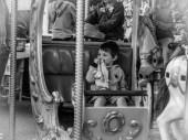 Child in the carousel in Grasse #monochrome