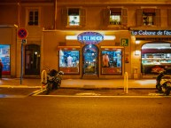 Night walk in Cannes. Store with a famous name in a street behind the Croisette
