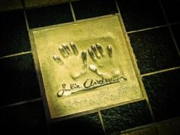 Julie Andrews hands plaque outside the Palais des Festivals