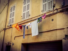 Space is limited in the Pannier so sometimes laundry is laid over the street, between windows #toycamera