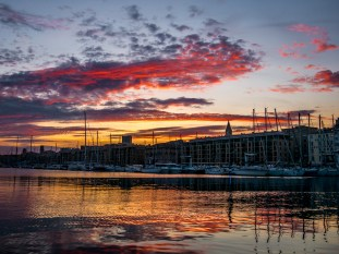 Fiery sunset in the old port of Marseille