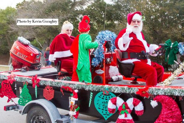 Santa Claus and Mrs. Claus at the 2013 Emerald Isle Christmas parade on a candy cane float