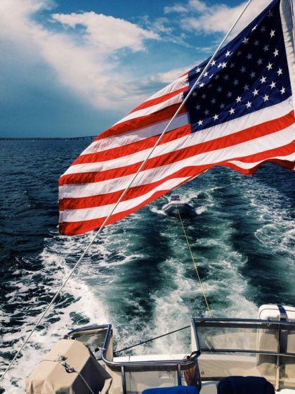 flag flying over ocean on boat in Emerald Isle NC