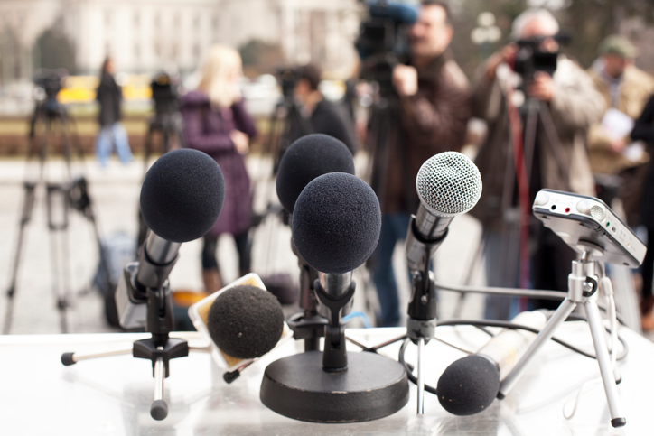 Microphones at a news conference. Press conference.