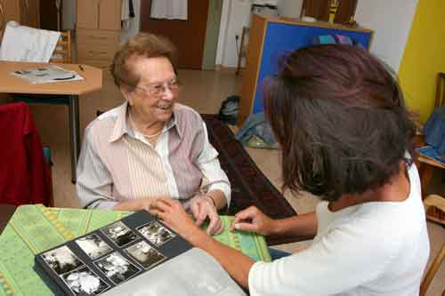 Elderly woman visiting with her guest
