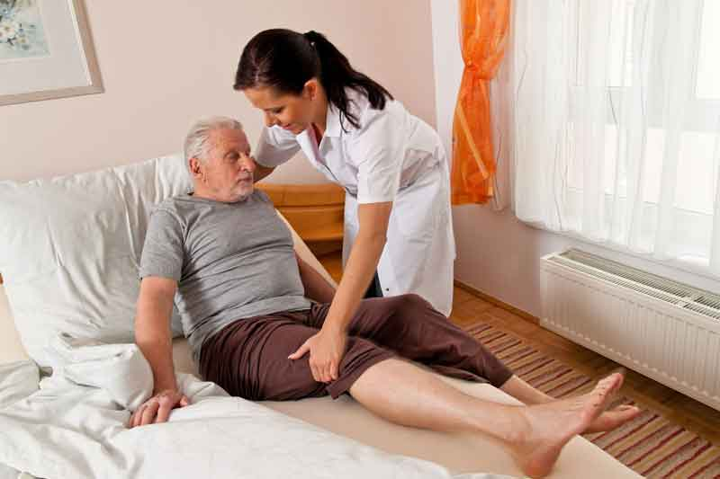 Home aid helps elderly man out of bed