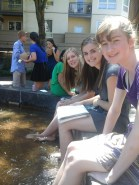 students smiling at fountain