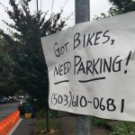 "Photo of sign reading ""Got Bikes, Need Parking!"" in front of new BIKETOWN station."