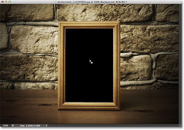 Selecting the area inside the photo frame with the Magic Wand Tool. Image &Copy; 2012 Photoshop Essentials.com