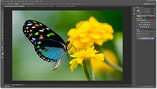 The floating documents have been consolidated to tabs. Image © 2013 Photoshop Essentials.com