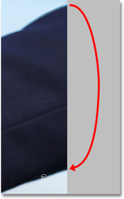 Moving into the pasteboard area with the Lasso Tool to select edge pixels. Image © 2009 Photoshop Essentials.com