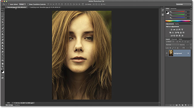 Making the portrait-oriented photo active by clicking its name tab. Image © 2014 Photoshop Essentials.com