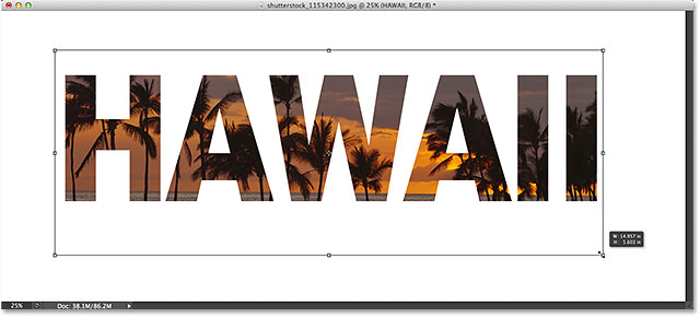 Moving and resizing the text with Free Transform. Image © 2014 Photoshop Essentials.com